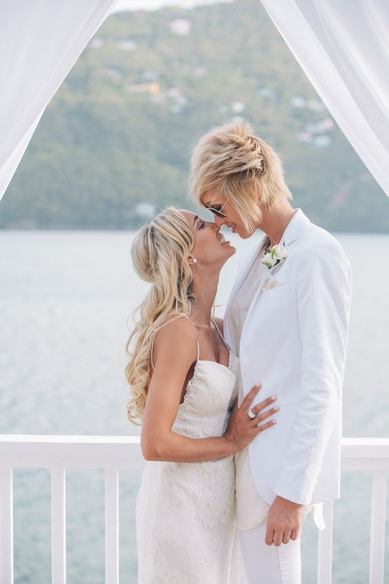 all-white bridal pantsuit with a boutonniere is a great idea