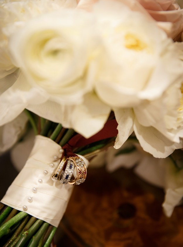 attach your parents' and grandparents' wedding rings to your bouquet for the ceremony