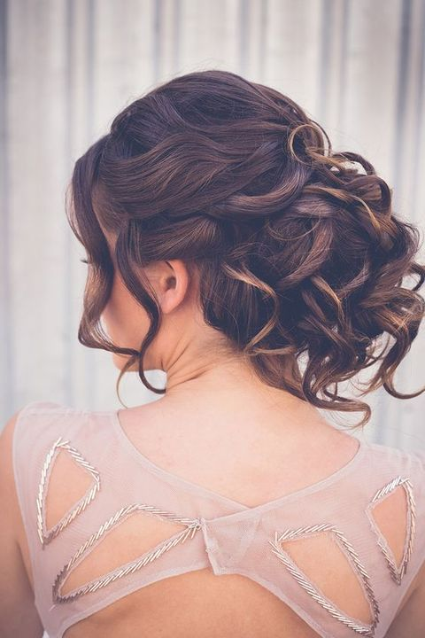 chic and messy curled updo looks very trendy