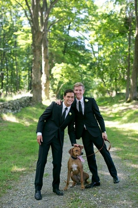chic black tuxedos with ties for both grooms