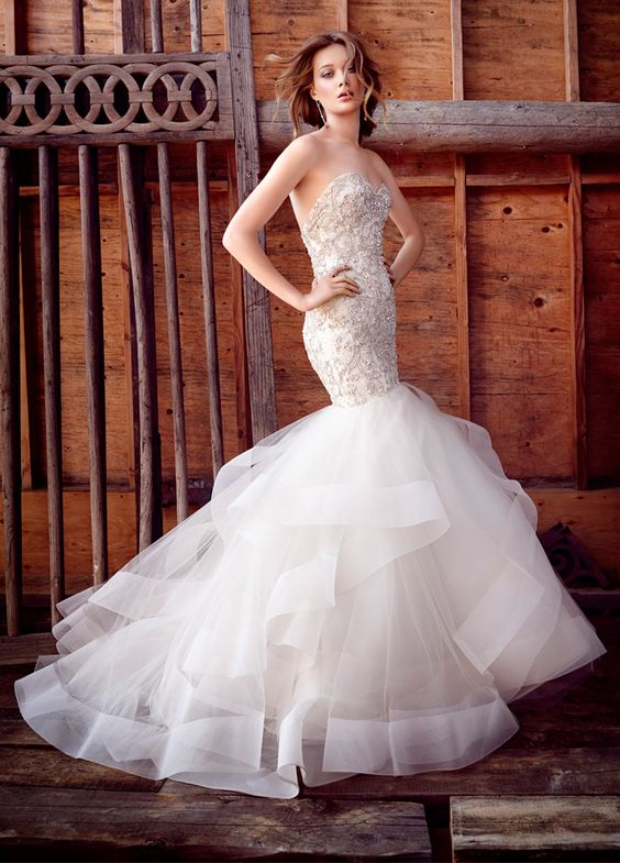 embroidered and embellished mermaid gown with a chic tulle tail