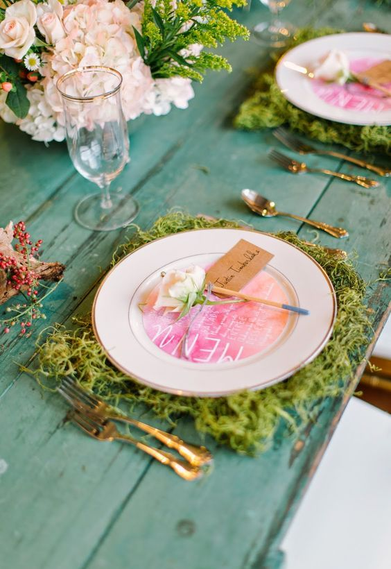 moss placemats and neutral blooms for a woodland or garden table