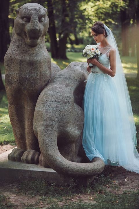 serenity blue wedding dress with an illusion neckline