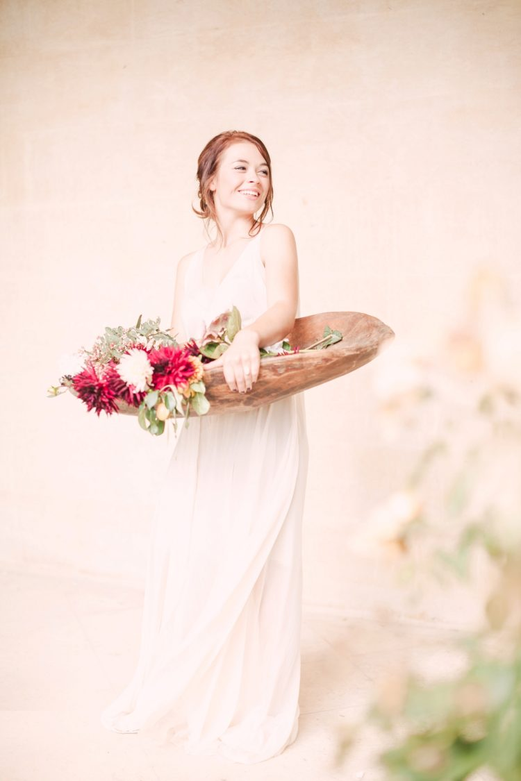 The bride was wearing a flowy tulle wedding dress with a V neckline