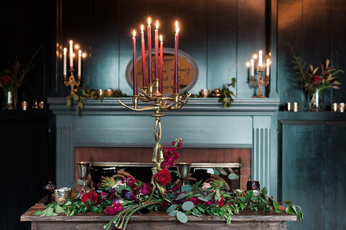 The venue was a dark one, with lots of candles and moody florals