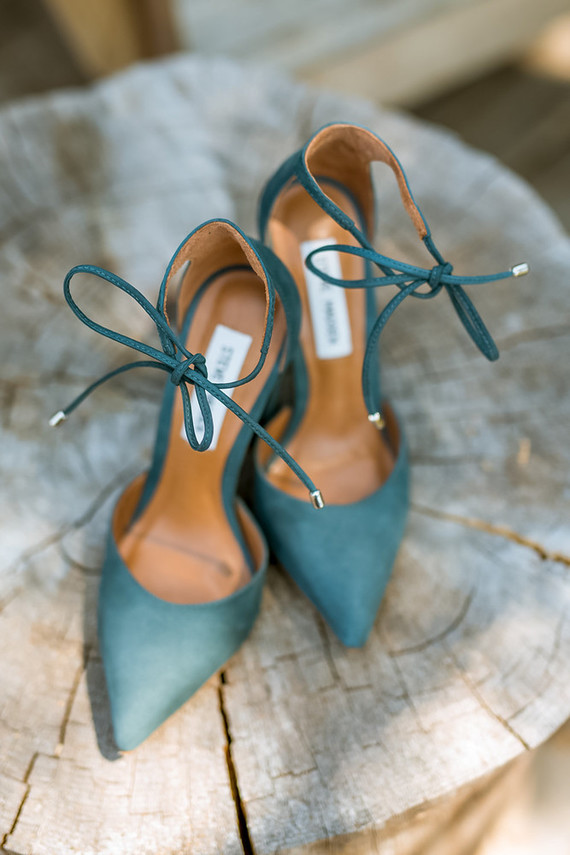 The wedding shoes hinted on the woodland wedding theme with their color