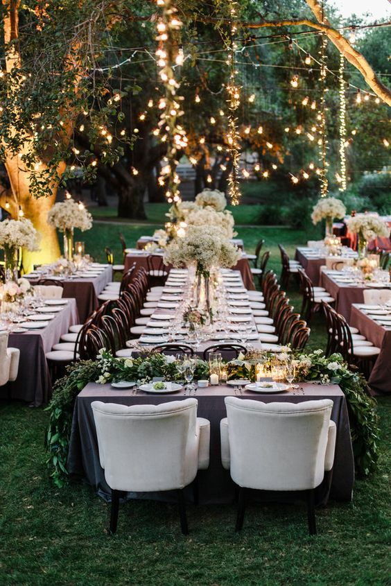 beautiful spring garden wedding reception with lights and greenery