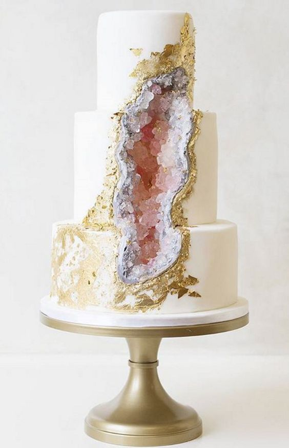 cute pink geode and gold leaf wedding cake