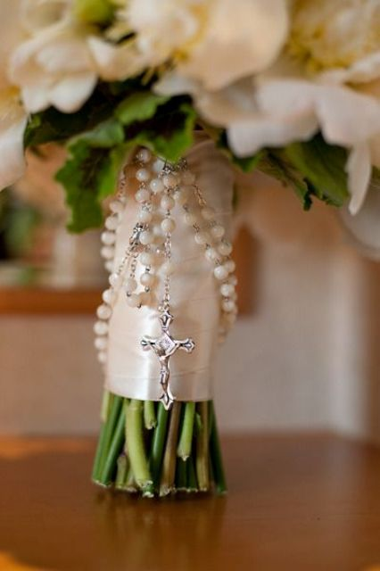 mom's or grandparents' rosary for wrapping the wedding bouquet