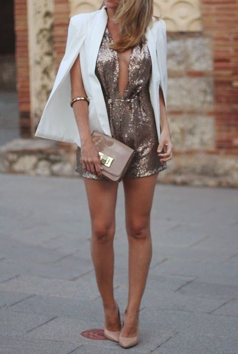 sequin romper, a white cape and nude heels