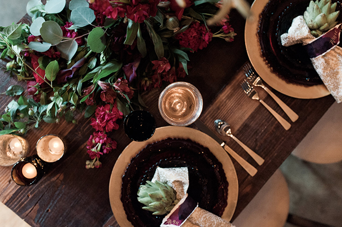Dark chargers and gold details together with bold florals are a recipe for a bold tablescape