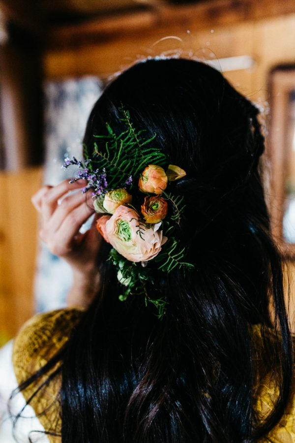 Flowers in the hair is a nice idea for a woodland bride