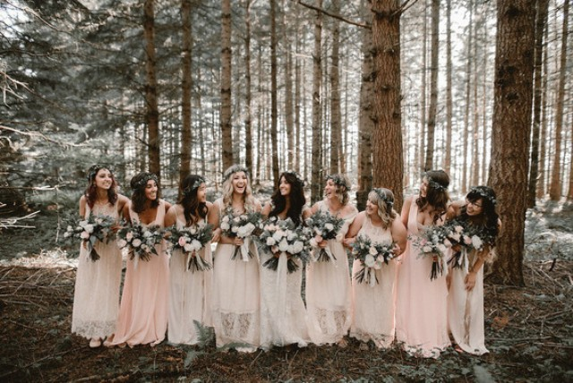The bridesmaids were wearing ivory and blush gowns and floral crowns