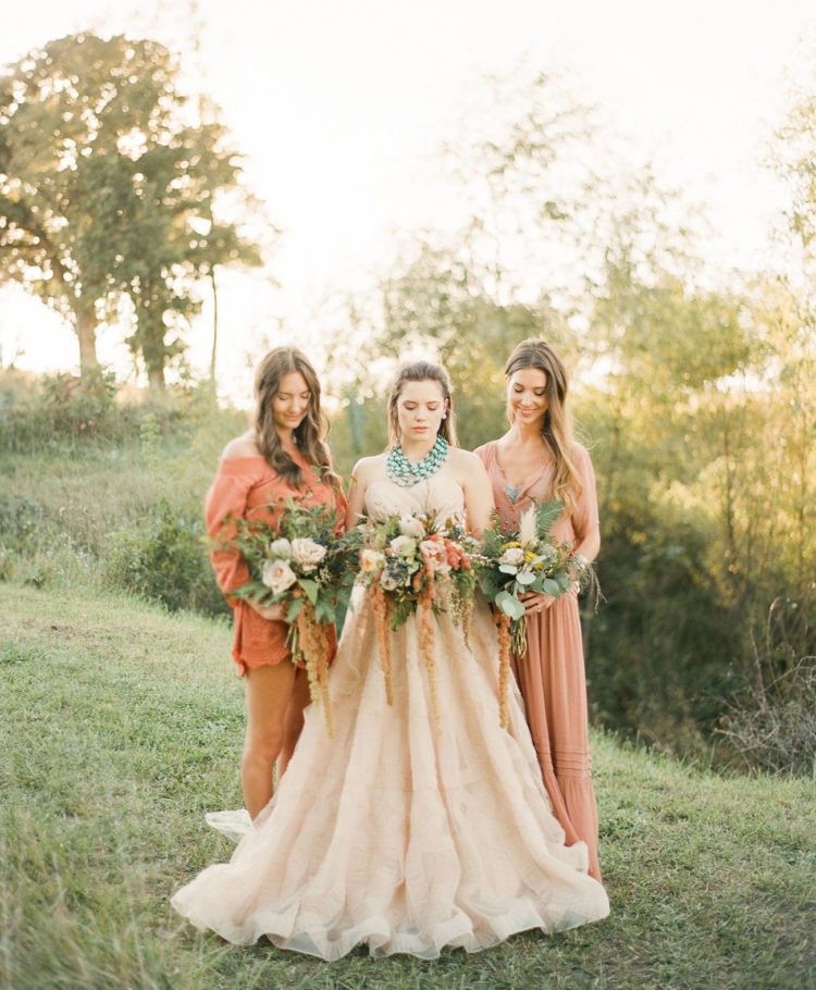 The bridesmaids were wearing red ocher dresses to stick to the wedding colors