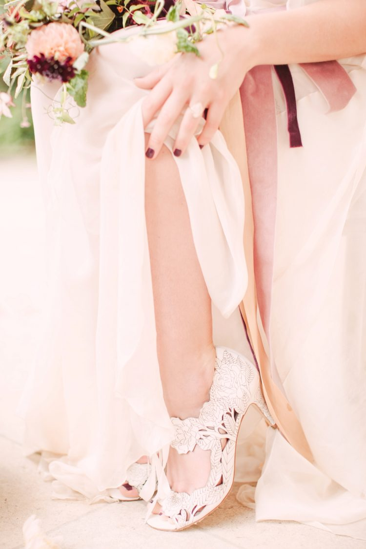 Vintage-inspired lace bridal shoes and marsala nails