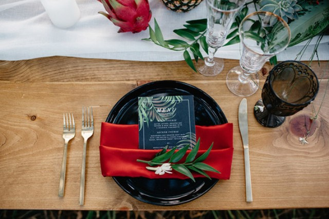 Each place setting had black chargers and bold napkins to stick to the colorful tropical decor