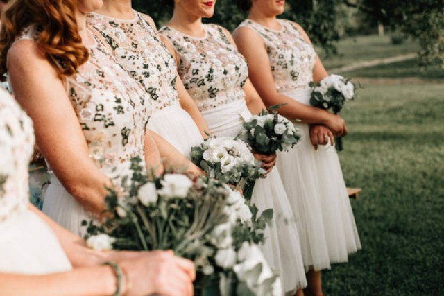 The bridesmaids were wearing separates with floral bodices and ivory skirts