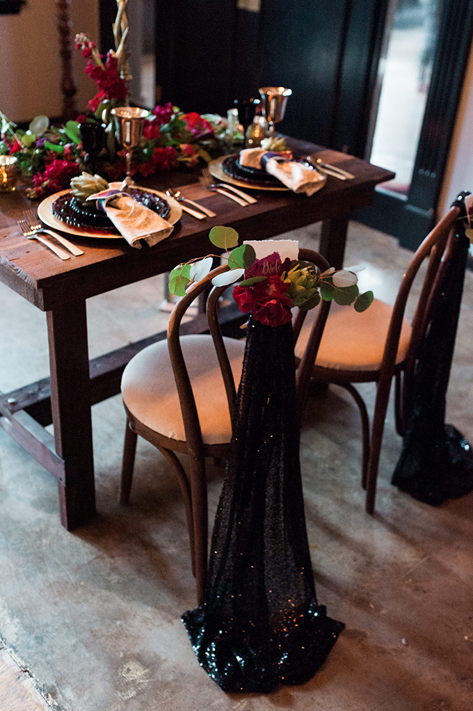 The chairs were decorated with bold blooms and black sequin fabric