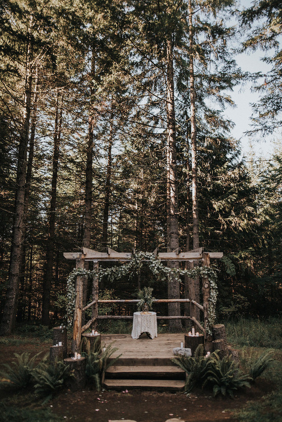 The wedding arbor was decorated with eucalyptus and candles