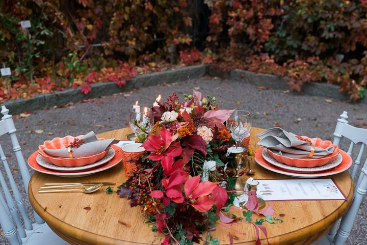 The wedding tablescape was just wow, with burgundy and red leaves, fresh greenery and some fall flowers