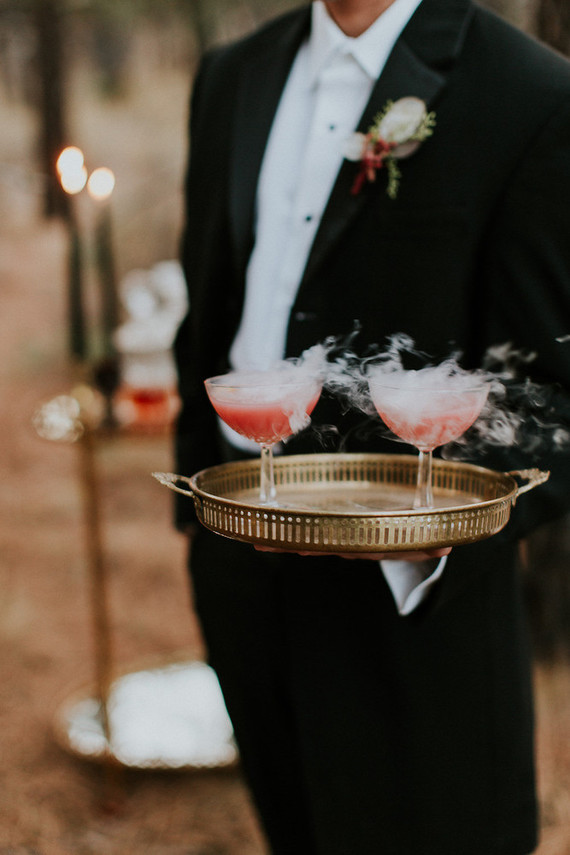 These smoking cocktails and the groom serving them look so haunted and unique
