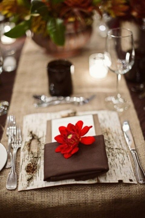 birch bark placemats, brown napkins and bold florals