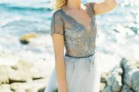 07 blue wedding dress with a lace embellished V-neck top and a plain light blue skirt