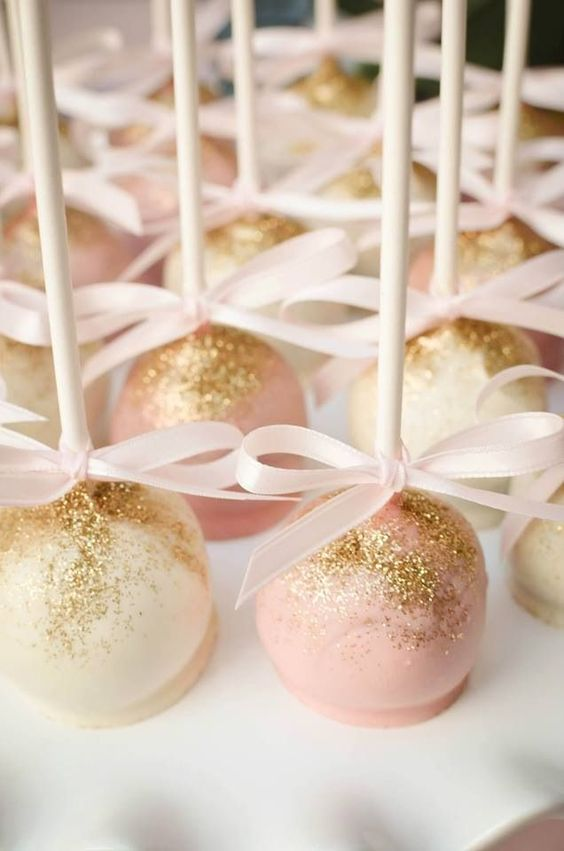 pink and white cake pops dusted with gold edible glitter
