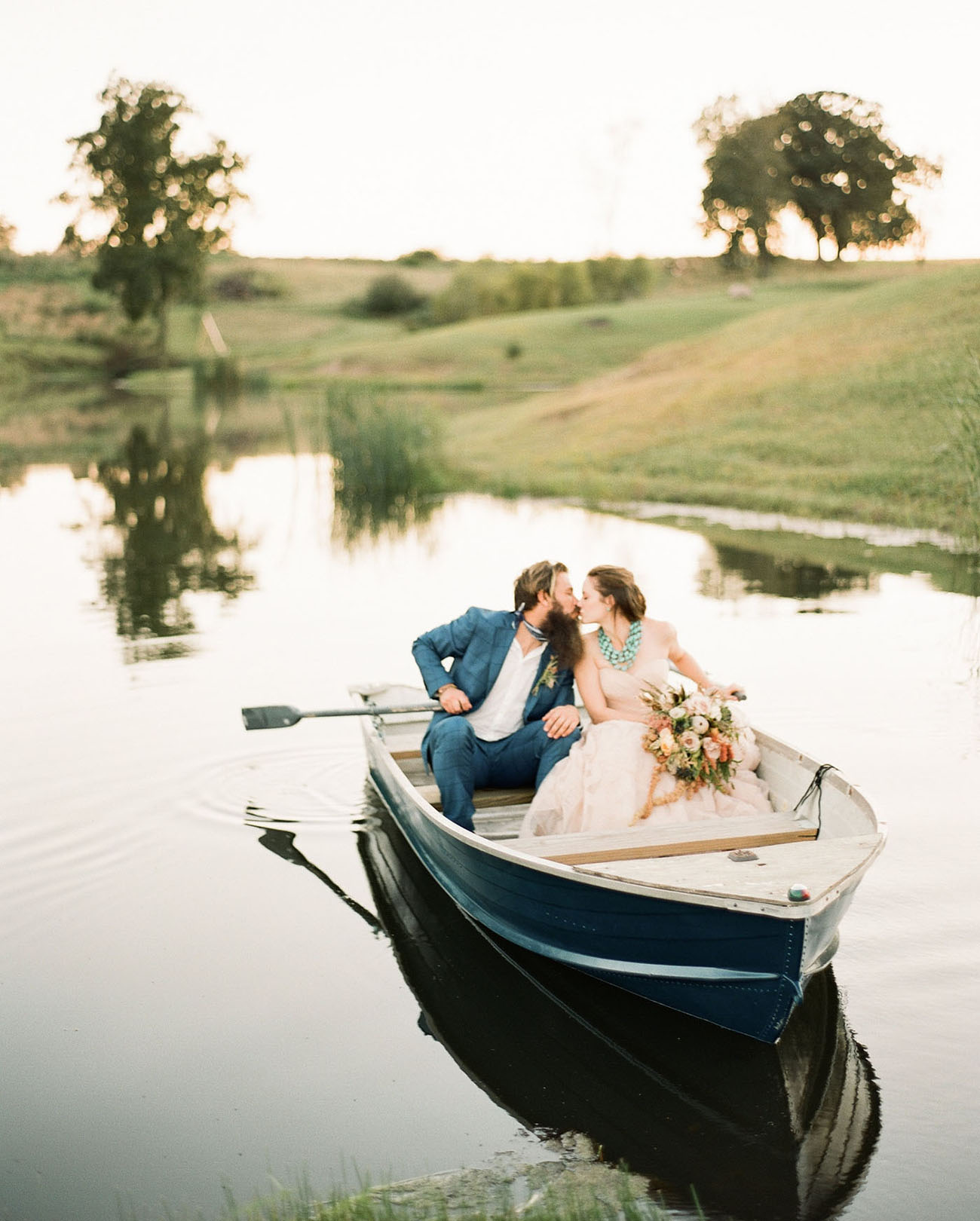 Of course there can't be no boat shot at a lake wedding