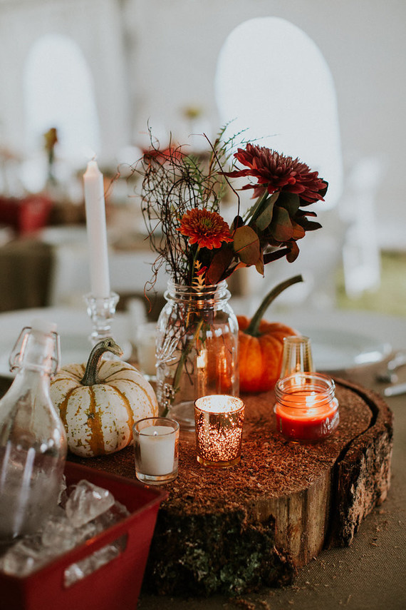 The centerpieces were complex ones of large wood slices, pumpkins, candles and fall flowers in vases