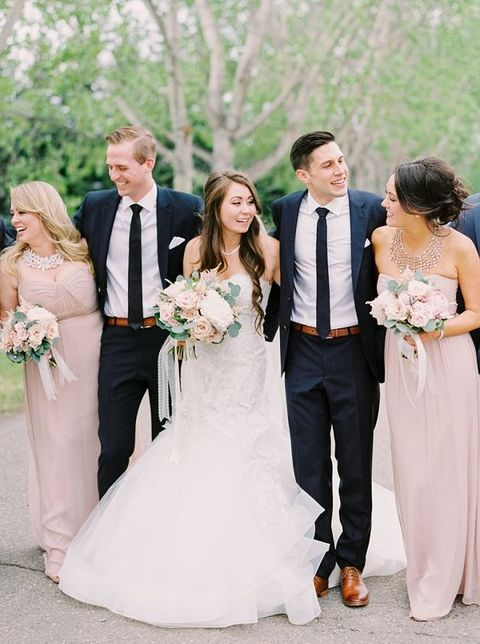 bridesmaids in blush an groomsmen in navy for an elegant look