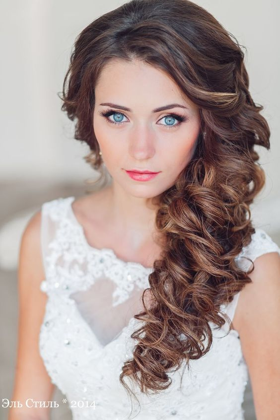 perfect side swept curly hair will look amazing for any wedding style