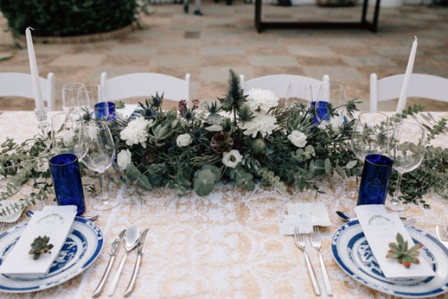 The tables were decorated in royal blue, white flowers and eucalyptus