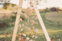 09 This is a wedding altar made of wooden beams and blush roses for a dreamy look