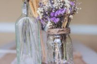 09 a log slice with lavender, spikes and flowers in jars make a cute centerpiece