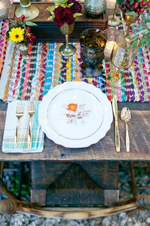 bold place setting with colorful textiles and flowers