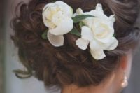 09 curled and braided updo with gardenia flowers
