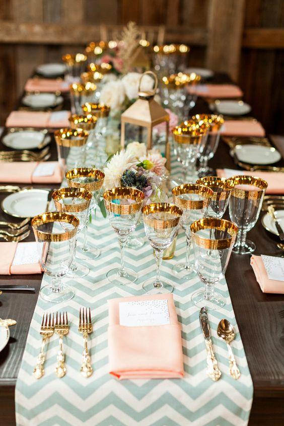 gold rimmed glassware, blush napkins and mint chevron table runner