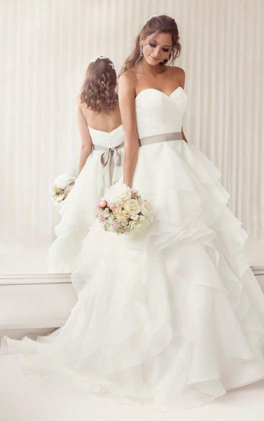 romantic sweetheart wedding dress with a layered skirt and a grey sash