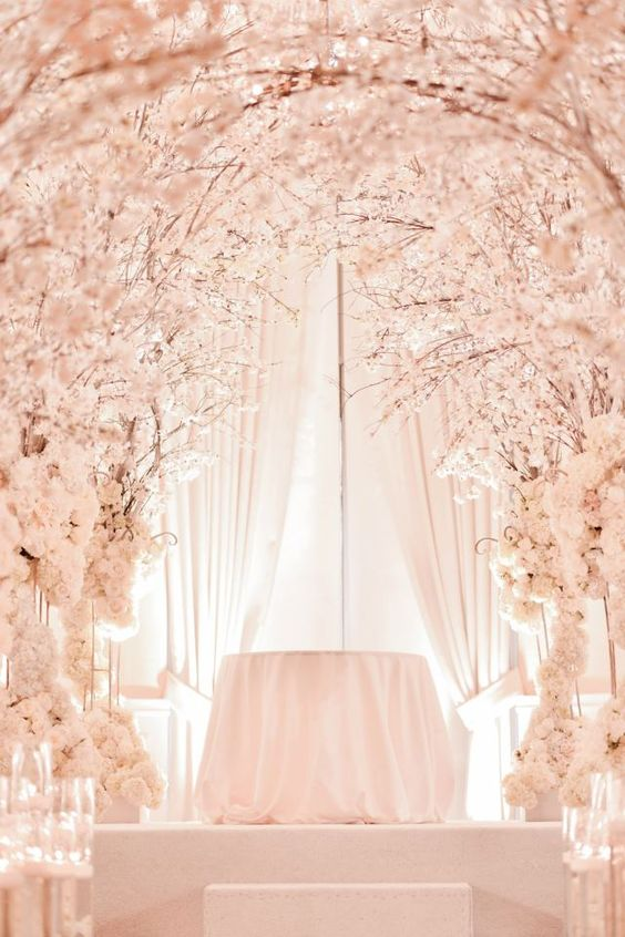 the ceremony spot and aisle covered with cherry blossom looks like a heaven