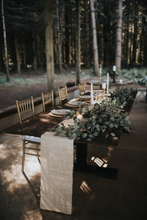 the tables were decorated with burlap, candles and eucalyptus