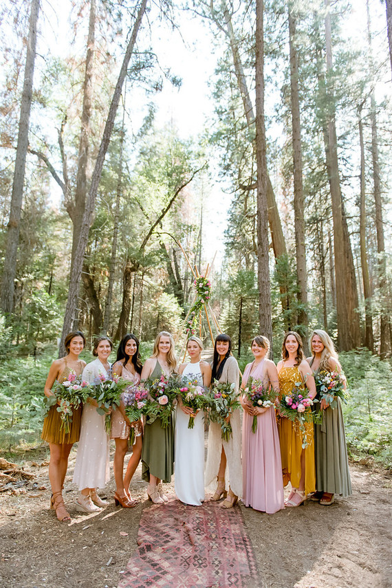 The bridesmaids chose from pink, mustard and olive green to fit the color of the wood