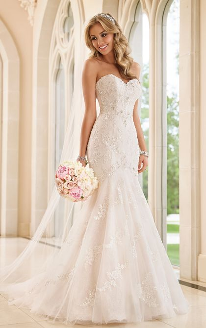 floral lace dress with embellishments and a mermaid silhouette