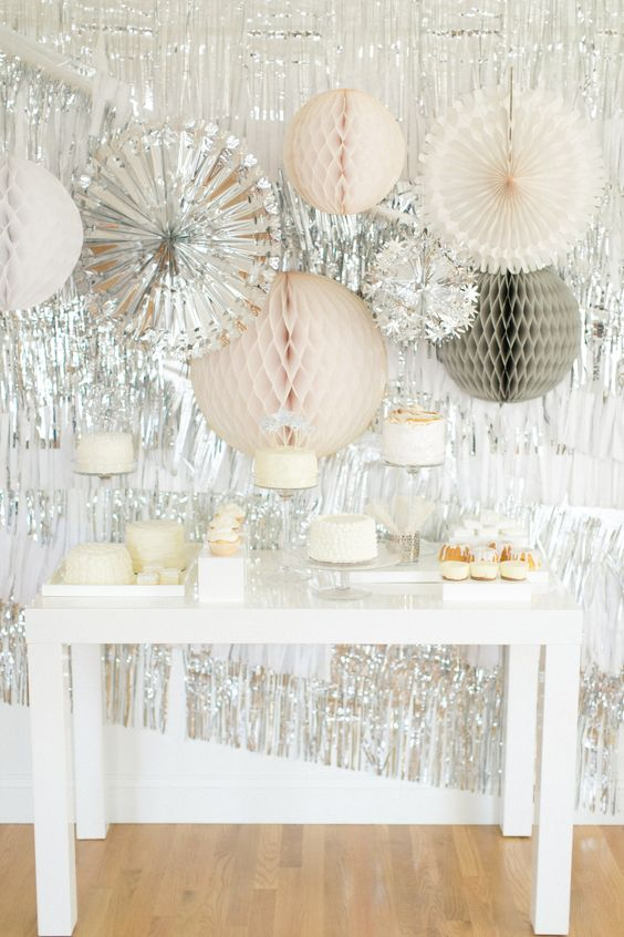 silver dessert table backdrop and oversized paper hangings