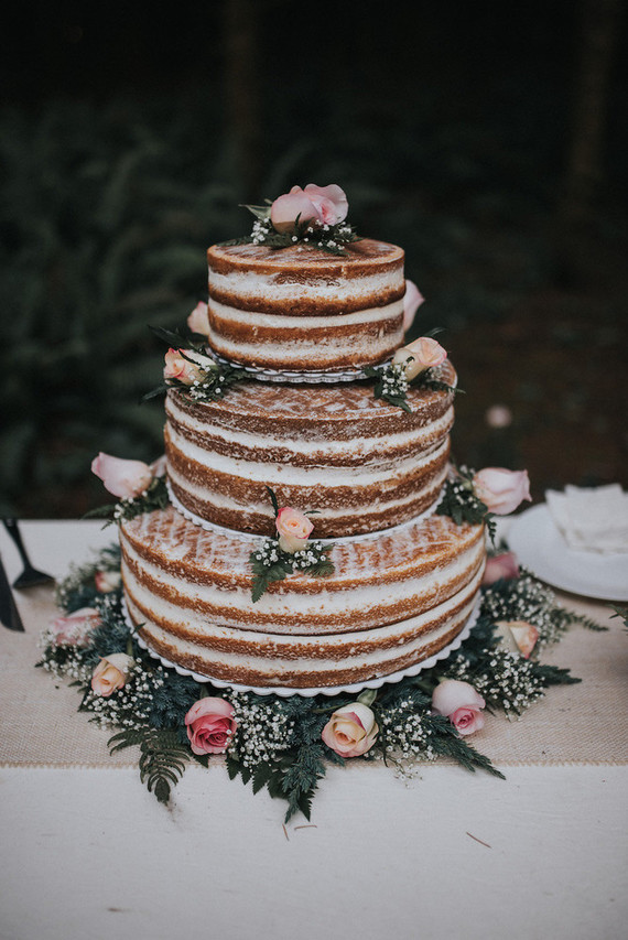 The cake was a naked one and topped with flowers