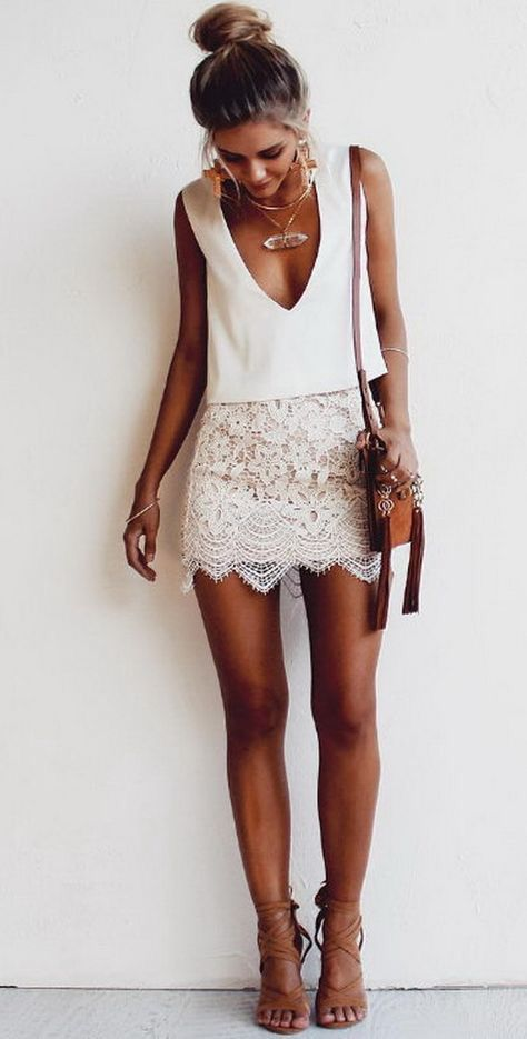 a lace mini, a white V-neck top and lace up heels