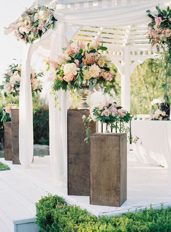 blush toned ceremony spot decorated with lots of flowers