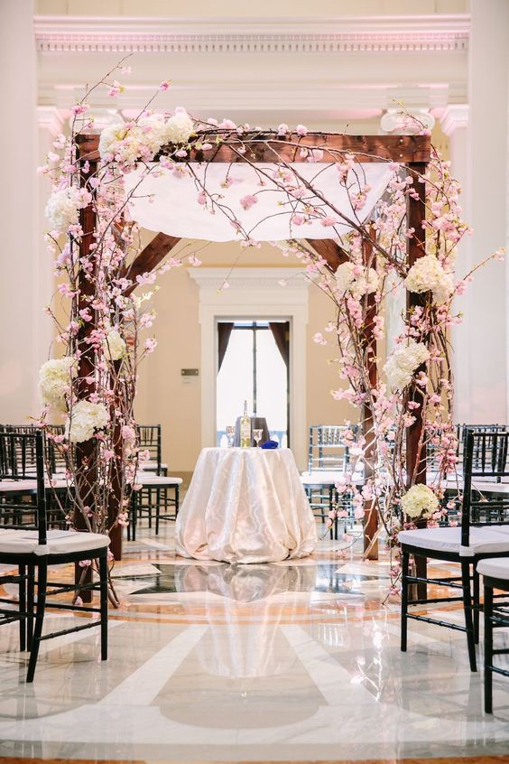 cherry blossom and ivory hydrangeas chuppah for a wedding