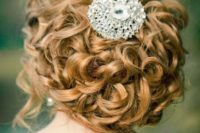 11 curled updo with a cool jewel hairpiece