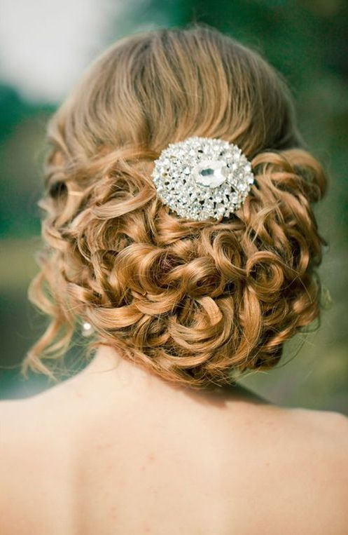 curled updo with a cool jewel hairpiece